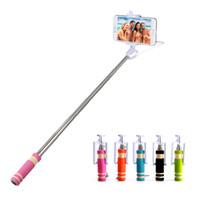 cabo selfie venda por atacado-NOVA Mini Foldable Self Stick Tripé Monopé Com Fio Selfie Vara Cabo Extensível Embutido Shutter Vara Para iPhone Smartphones MOQ: 100 PCS
