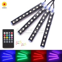 4Pcs Wireless Remote Music Voice Sound Control Auto RGB LED Flash Luce interna al neon Strip Dash Floor Atmosphere Lights