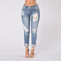 ingrosso jeans sfilacciati per le donne-Jeans a vita media Jeans aderenti blu Jeans sfilacciati Pantaloni skinny strappati a sbiancato da donna Pantaloni denim per donna
