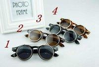 lunettes de soleil goth achat en gros de-Nouveau Steampunk Goth lunettes de soleil lunettes rondes en métal rétro cercle Flip Up UV400 lunettes 4 couleurs 100pcs SG04