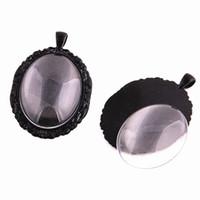 ingrosso cameo cabochon nero-3 set nero cameo 38 * 58mm (misura 30 * 40mm dia) ovale cabochon pendente impostazione gioielli charms bianco + cabochon in vetro trasparente D0776-2