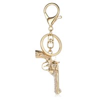 Wholesale gun keychains - Fashion Gold Color Lobster Clasp Keyring Dangle White Rhinestone Gun Charm Metal Keychains For Men Car Accessories