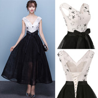 Wholesale Short Lace Vintage Corset Dress - 2017 White And Black Elegant Tea Length Full Lace Prom Dresses Bateau Neck Cap Sleeves Corset Back Pearls A-line Party Gowns with Bow