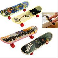 Wholesale Mini Scooter Toys - Wholesale-1pcs Mini Finger Skateboard Fingerboard Mini Skate Plastic Stents Scrub Finger Scooter Skate Boarding Game Toy Random