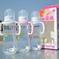 Wholesale Baby Product Bottle - Wholesale- 2015 Baby feeding bottle for 280 ml p.p material safety automatic suction pink and blue newborn feeding products retail NP002