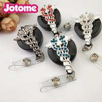 Wholesale Nurse Id - Wholesale In China Rhinestone Nurse Medical Doctor Symbol Cossing with two wings Rhinestone button  ID Badge Protectors
