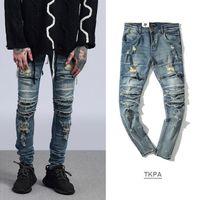 luces de la calle de la vendimia al por mayor-Hombres de High Street Ripped Slim Fit Jeans Cortes de rodilla Kanye West Pantalones largos desgastados Pantalones azul claro vintage