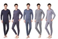 Wholesale Winter protection thermal underwear suit Mmen warm thermal underwear round neck cotton winter bottomin suits Free Gift