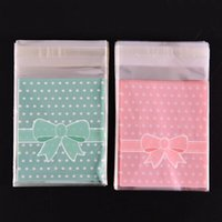 Wholesale Gift Bags Paper Bow - Wholesale-100Pcs bag Gift Sealing OPP Plastic Lovely Pink Blue Bow Adhesive Cake gift Packages Cookie Candy Pack Christmas Paper bags