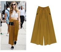 Moda feminina Loose Lagre Size Casual Pants Europa e América Fashion Tie Solid Color Loose Ninth pants