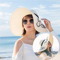 Wholesale Summer beach sun grass straw hat European and American style women s festival wide brimmed hat China s hit TV series song of joy And