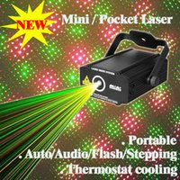 Wholesale laser light show system - Wholesale- New Mini Laser Projector 4in1 Patterns Lights For Wedding Party Decoration China Sex Laser Light Show System