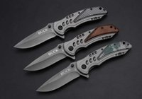 Wholesale Buck Titanium - Free shipping buck - x57 quick opening folding knife knife of titanium coating on 5 cr13mov 57 HRC special outdoor camping survival knife