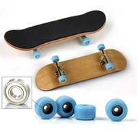 Wholesale maple wood toys resale online - Wood Finger Skateboard Alloy Stent Bearing Wheel Fingerboard Novelty Kids Toys Professional Type Bearing Wheels Skid Pad Maple
