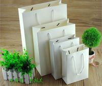 Wholesale Paper Advertisement - Wholesale- wholesale 500pcs lot custom logo 10 Sizes white paper bag shopping bag clothes jewellery bag for advertisement free shipping