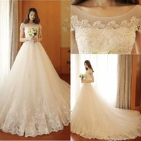 2017 Vintage Lace Ball Gown Robes de mariée Arabic Boat Neck Beads Appliques Robes de mariée taille grande Backless Lace Up Bridal Gowns