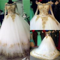 vestido de novia de marfil dorado al por mayor-Vestidos de boda de marfil del vestido de bola de Tulle apliques de encaje de oro Bling Bling perlas lentejuelas de ilusión largos Vestidos de novia de la manga de lujo
