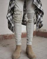 ingrosso uomini di tuta coreana-All'ingrosso-kpop skinny strappato pantaloni hip hop moda cool Mens abbigliamento urbano tuta Jeans uomo kanye west slp paura di dio