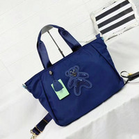 Wholesale Genuine Leather Handbags Korea - Europe and Japan and South Korea shoulder messenger bag handbags Oxford cloth bag counter leisure sequins bear large capacity quality