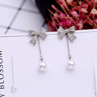 Wholesale American Version - New European and American version of the long pearl earrings female 925 silver needle earrings simple tassel bow allergy