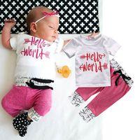 ücretsiz gönderim çocuk t-shirt toptan satış-Çocuk takım elbise Yenidoğan bebek Kız çocuk sevimli T-shirt Tops + Pantolon tayt mektup baskı Kıyafet pamuk giyim Seti 2 adet butik giysi ücretsiz gemi