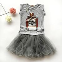 şişe kız kıyafeti toptan satış-Kızlar giyim setleri butik çocuk giysileri yaz bebek parfüm şişesi baskı payet gömlek kısa kollu + fırfır tutu etekler çocuk kıyafetler