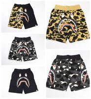 Wholesale Japan Fashion Pants Men - Wholesale 14 colors Japan stly tide brand Men Beach camo shark shorts men casual pants lovers loose shorts