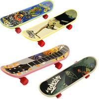Wholesale plastic mini skateboard online - High quality novelty cute mini children toys skateboard athletic finger skateboard gifts for the children C2412