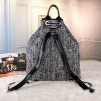 Wholesale Metallic Laptop - Europe M Luxury brand women bag School Bags Fashion Famous designers rivets backpack women travel bag backpacks laptop bag Free shipping