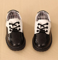 Wholesale British Boys - British fashion style boys girls leather shoes student performance shoes black white Hollow children casual kids sports sneakers