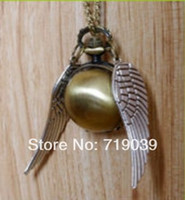 Wholesale Watch Wholesalers Singapore - 10pcs lot Hot wholesale silver wings HP gold golden snitch pocket watch necklace 2014,original factory supply