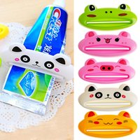 Wholesale Toothpastes Tube Holder - Wholesale- NEW Bathroom Tube Rolling Holder Squeezer Easy Cartoon Toothpaste Dispenser ABS