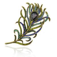plumas de pavo real de metal al por mayor-Pluma de la vendimia Broche de bronce Pin Antique Gold Crystal Rhinestone Metal Peacock Feather Broche Accesorio de la joyería de DHL Envío gratis