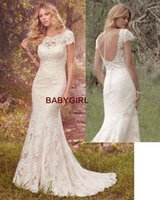 Wholesale Wedding Lace Motifs - Custom made fit and flare Mermaid Wedding Dresses layers crosshatch-patterned tulle and romantic lace motifs over a luxe Inessa jersey slip