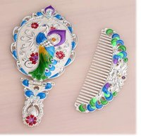 Wholesale Blue Peacock Combs - high-grade Virgo Girls Russian price of Russian guards Princess portable handle peacock imitation copper mirror comb trade goods