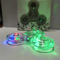 LED Fidget Spinner Luminoso cristallo lucido spinners Glitter Jelly Clear Lucidi luci trasparenti Tri figertips Spinner Focus Toy nuovo