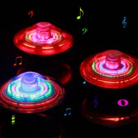 12pcs LED Flashing Light UFO Spinning SpinTop Beyblade Gangnam Style Musique Laser rotatif TOP Wind Up Kids Toy Décoration de fête de noel