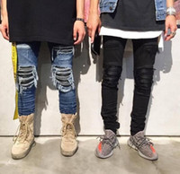Wholesale hip hop blue jeans - Fashion skinny ripped hip hop fashion pants cool mens urban clothing jumpsuit men's jeans kanye pants slp fear of god