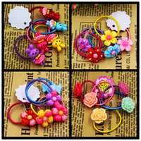 Wholesale Hair Elastics Flowers - Wholesale- 5pcs lot Child Baby Girls' Hair Holders Rubber Bands Elastics Rabbit Candy Rose Flowers Super Cute 2015 New Fashion Tie Gum