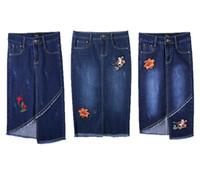 bultos de revestimiento al por mayor-Las nuevas mujeres de la manera falda de los pantalones vaqueros destellan el código A-line vestido de la cadera bordado vaquero busto femenino Jean faldas de la venta caliente