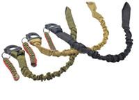honda usada al por mayor-Cinturón elástico de uso múltiple de liberación rápida Eslinga de protección Cordón Línea de seguridad Kits de supervivencia de Airsoft Escalada al aire libre Cuerda de sombrilla para acampar