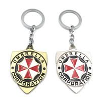 kristal şemsiye toptan satış-Yeni Varış Resident Evil Umbrella Corporation Logo Anahtarlık Metal Alaşım Anahtar Yüzükler Toptan 10 adet / grup Blister Pacakge