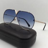nuevos abrigos de moda al por mayor-Nuevos hombres mujeres diseñador gafas de sol Z0898E gafas de sol de moda oval recubrimiento espejo lente marco de metal hueco color plateado marco UV400 lente