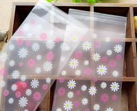 paquetes de dulces azules al por mayor-100pcs Pretty Pink Blue Frosted Daisy Candy Cookie Bags, Bolsas de plástico autoadhesivas, Joyas pequeñas o Accesorios Bolsas de embalaje