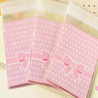 Wholesale Gift Bags Paper Big - Wholesale- Big Sale 100pcs bag OPP Plastic package bag Lovely Pink or Blue Bow Design Cake gift Packages Candy Pack paper