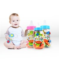 Atacado 3-24 meses 8pcs / set Baby Rattle Bottles Bell 8 Woolly Baby Teeth Early Childhood Educational Toys Wholesale Bell Fabricante