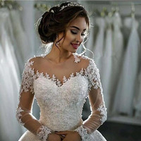 Wholesale Elegant Long Sleeve Gowns - 2017 New Dubai Elegant Long Sleeves A-line Wedding Dresses Sheer Crew Neck Lace Appliques Beaded Vestios De Novia Bridal Gowns with Buttons