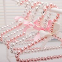 Wholesale Wholesale Pant Hangers Clips - White Pearl Pet Clothes Rack Teddy Dog Clothes Hangers Bowknot Pearl Hangers for Baby Infant Fashion Pearl Hanger 20 p l