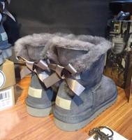 sapatos baixos mulher beading venda por atacado-2017 novas botas de neve mulheres no tubo de lã de pele de carneiro uma fita arco flat sapatos de algodão antiderrapante além de veludo botas de inverno quente