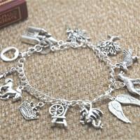 verdaderas pulseras de amor al por mayor-12 unids Maléfica pulsera inspirada Castle Fairy Tree Crow Alas de lobo Dragon Horse True Love charm pulsera